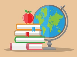 an apple on a stack of books next to a globe